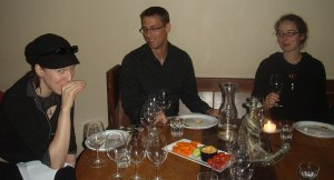 Conoisseurs Julye (left), David (center), and Jeanine (right) share a laugh and some notes over reds and whites.